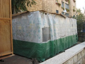 An example of a sukkah outside of an apartment building in Jerusalem.